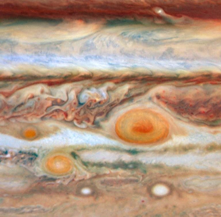 Jupiter's third red spot (far left) took a beating when it tried to pass between the Great Red Spot (right) and Red Spot Junior (lower left)
