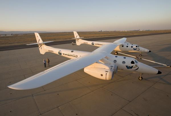 The carrier plane WhiteKnightTwo has two fuselages and will carry SpaceShipTwo between them