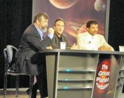 Sykes (left) and Tyson (right) debate the planet definition question as moderator Ira Flatow looks on