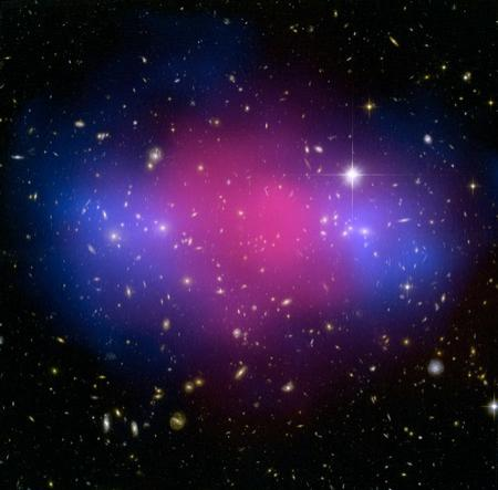 Hot gas (shown in pink) in two merging galaxy clusters slowed down after impact, but their dark matter (blue) continued on unimpeded. Astronomers made this map of the clusters' matter distribution by studying how their mass gravitationally distorted light from background galaxies