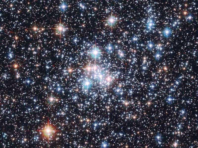 A cluster of newborn stars might share life-bearing rocks between them.