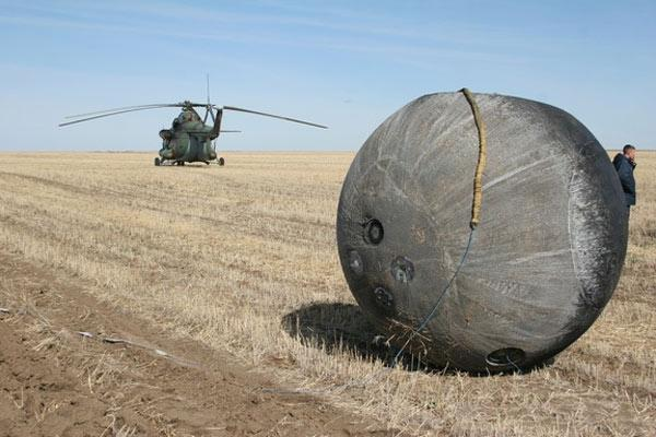 Earth rocks were attached to the bottom of a Foton M3 capsule's heat shield, shown above after landing in Kazakhstan