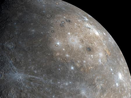 Buff-coloured volcanic plains in Mercury's huge Caloris impact basin are shown in this mosaic of images taken during Messenger's first flyby on 14 January. As much as 95% of Mercury's surface will be mapped after Messenger's second flyby on 6 October, allowing researchers to estimate for the first time what fraction of the surface is covered by volcanic lava flows