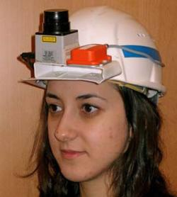 A helmet with a laser scanner (left) and inertia-measuring sensor (right) taped in place feeds data to software able to build up maps of the area a person walks through