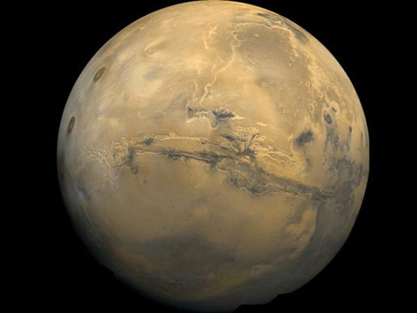 The 4000-km-long Valles Marineris is the Red Planet's Grand Canyon. Narrow outcrops of opal are found in and around the canyon. The minerals may be quite extensive - covering regions spanning 1000 km - but are only seen where erosion has cleared away overlying dust and rocks