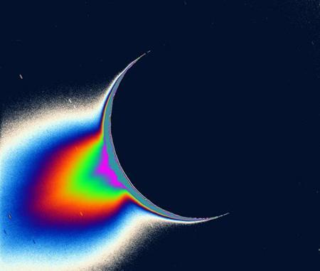 Jets of fine, icy particles erupt from the south polar region of Enceladus
