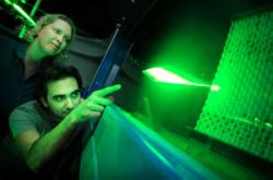 Two of the team members watch the artificial shark skin within a water tunnel to study its fluid dynamics