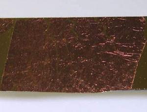 A rust-coloured sheet of porous gold covered in an invisible coating of plant proteins provides a whole new way to tap solar energy