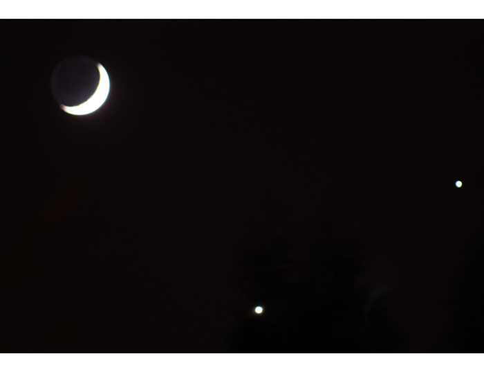 This image of the Moon, Jupiter (right) and Venus (bottom) was taken from Cambridge, Massachusetts, on Monday evening