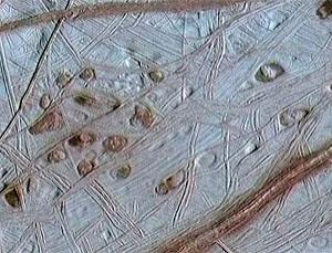 The scarred surface of Europa may be due to the push and pull of Jupiter's gravity