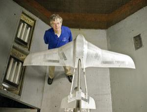 Project leader Joel Levine with a model of the aircraft undergoing testing in a NASA wind tunnel