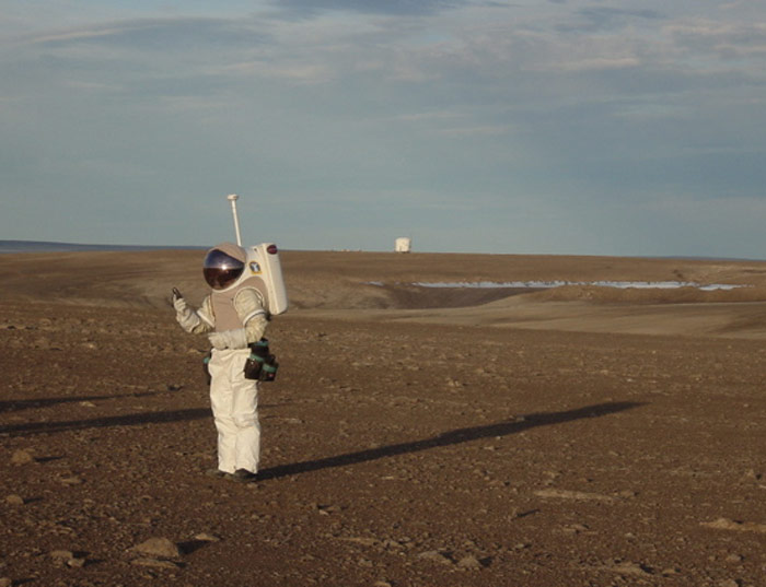 Dr Jeff Jones of NASA's Johnson Space Center tests a spacesuit in the Canadian Arctic