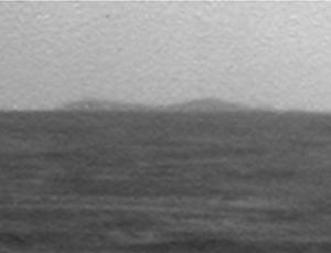 The Mars rover Opportunity caught a glimpse of its distant quarry, Endeavour Crater, on the horizon earlier this month. The large, rimmed crater is still 12 kilometres away as the crow flies, the same distance Opportunity has driven in its five years on the Red Planet