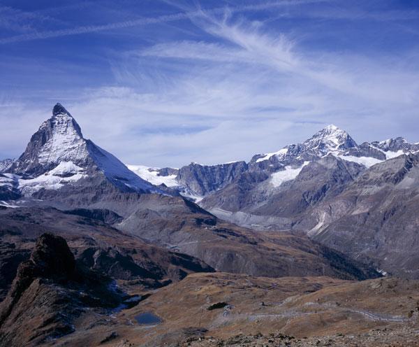 The Matterhorn (left) sits right on the Swiss-Italian border