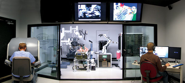 This mobile operating theatre comes with a team of robots, one of which is remotely controlled by a surgeon