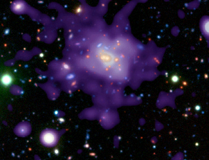 A clutch of massive galaxies that seem to be almost fully-formed just 5 billion years after the big bang challenge models that suggest galaxies can only form slowly. Tendrils of dark matter that fed the young galazxies on gas could be to blame (NASA/CXC/ESO/P Rosati et al)