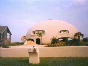 Rounded homes like this can survive extreme weather better than conventional structures - click the link in the main text to see how it fared in a hurricane