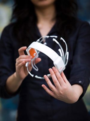 The Emotiv headset picks up the electrical activity of neurons firing inside a person's brain and interprets your thoughts to control a computer game