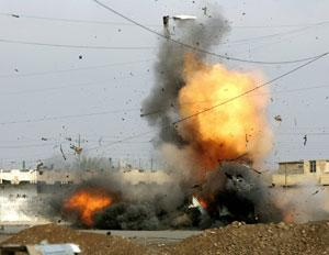 An improvised bomb is blown up by an Explosive Ordinance Disposal Special Unit in northern Iraq in late 2005. Bomb disposal is a notoriously dangerous job