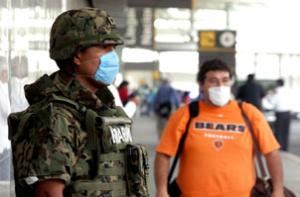 Soldiers distribute face masks to travellers at the International Airport in Mexico City