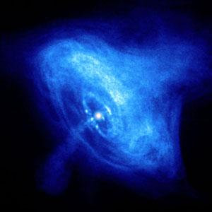 A snapshot from a movie showing dynamic rings, wisps and jets of matter and antimatter around the pulsar in the Crab Nebula. The inner ring is about one light year across