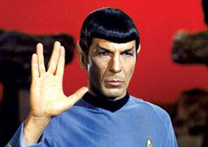Leonard Nimoy, as Spock, giving the Vulcan salute. In the fictional universe of Star Trek, the Enterprise is powered by a matter-antimatter reaction
