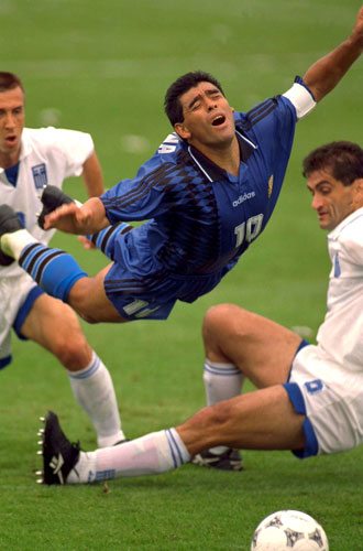 Diego Maradona flies dramatically through the air after a Greece challenge in the 1994 World Cup