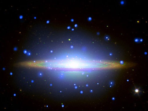 The Sombrero galaxy, M104, is also thought to have a supermassive black hole at its heart. This composite image shows X-ray, visible light and infrared