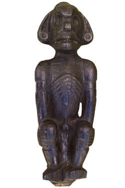 This wooden figurine is a Taino weather spirit, which the people consulted to predict storms