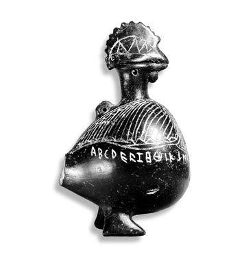 An Etruscan vase or inkwell in the shape of rooster, from Viterbo, circa 600 BC. It is inscribed with the letters of a