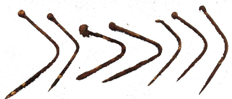 Eight bent brass pins from the bottle, the longest 3.2 centimetres