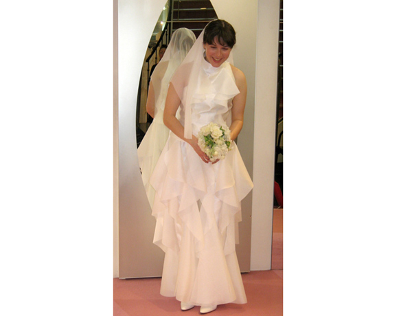 The bride's wedding dress was designed to billow out in all directions as she tumbles and twirls about in zero gravity
