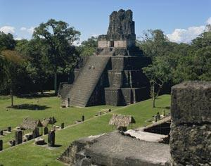 Temple II at Tikal, Guatemala, Central America. New evidence suggests that the Mayan civilisation collapsed because of a lack of resources rather than other factors such as disease or warfare