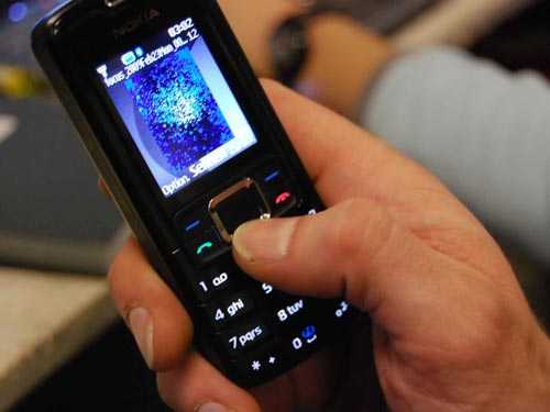 A researcher captures images on the handset