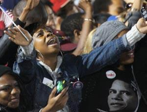 Black Americans celebrate after hearing that Barack Obama is going to be the next President of the United States