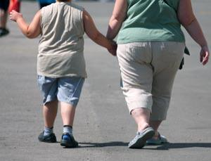 Overweight and obese people may be more at risk from swine flu.