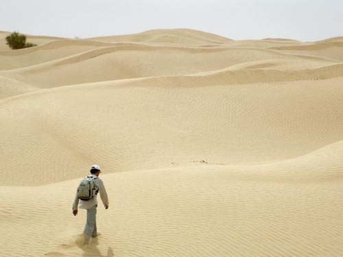 A participant during the desert experiment. On this day the sun was visible and the subject was not blindfolded. He was able to walk in a reasonably straight line