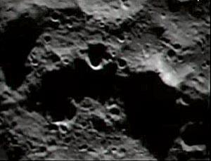 Nothing to see here. The impact was due to occur to the left of the large crater shown in this image, but there was curiously little to see