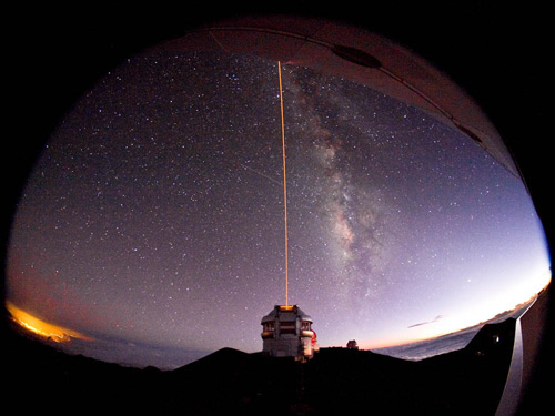 The Gemini North observatory in Hawaii fires a laser into the sky as part of its adaptive optics system