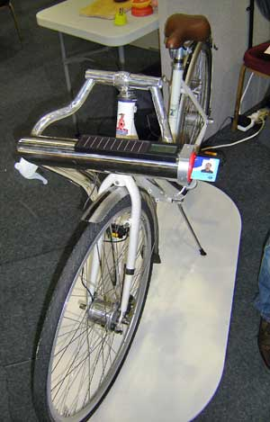 When pedalled this bike charges an on-board supercapacitor that can feed power back to the grid, by inserting their travel pass the user can receive transport credits for their efforts