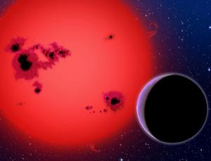 This artist's conception shows the newly discovered super-Earth GJ 1214b, which orbits a red dwarf star 40 light years from Earth. It was discovered by the MEarth project - a small fleet of ground-based telescopes no larger than those many amateur astronomers have in their backyards