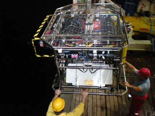 The Hy-Bis underwater vehicle is launched from the deck of the Jame Cook