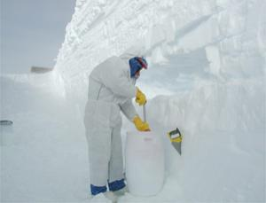 A researcher collects a snow sample near the Concordia Research Station in Antarctica