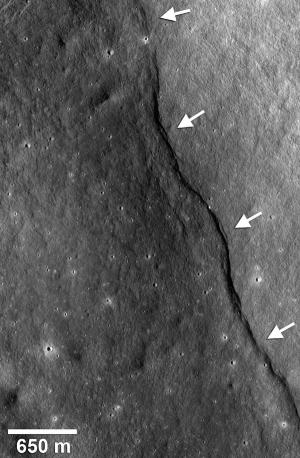 As the moon cooled and contracted, a thrust fault pushed its crust (arrows) up the side of an impact crater named Gregory