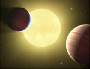 Two Saturn-sized planets travel in synchronised orbits around the star Kepler-9