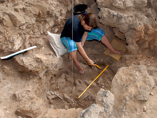 Archaeologist Natalie Munro excavates the grave of a woman thought to have been a shaman
