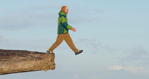 Man walking off a cliff
