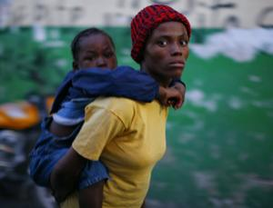 A Haitian child with symptoms of cholera is carried to a hospital