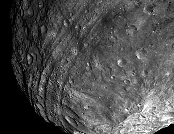 Grooves wrap around Vesta's equator in this image taken from 5200 kilometres away. They likely formed in the wake of a giant impact at Vesta's south pole