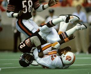 Yet another hard knock: Dave Duerson (dark helmet) later killed himself, fearing he had dementia